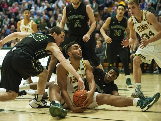 Vermont's Anthony Lamb (3) calls time out as he battles for the loose ball during the men's basketball game between the Dartmouth Big Green and the Vermont Catamounts at Patrick Gym on Dec. 7, 2016 in Burlington.
