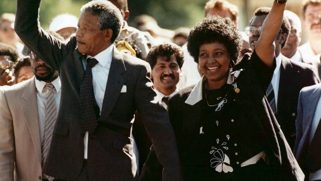Nelson Mandela (left) and his wife, Winnie, walk out of the Victor Verster prison in Paarl, near Cape Town, South Africa, Feb. 11, 1990, after Mandela had spent 27 years in prison.