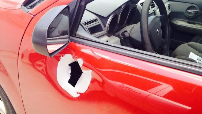 Gunshot hole on the vehicle of a News-Press delivery driver who suffered minor injuries.