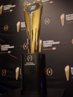 A gold football-shaped trophy will be the champion's prize in the College Football Playoff.