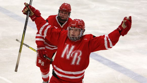 North Rockland's Dylan Cool (62) celebrates his third period goal against Suffern during the Section 1 hockey championship game at Brewster Ice Arena Feb. 24, 2018. North Rockland won the game 3-2.