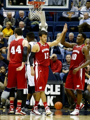 Wisconsin forward Nigel Hayes, right, and forward Duie Dukan, left, celebrate during the first half against California.