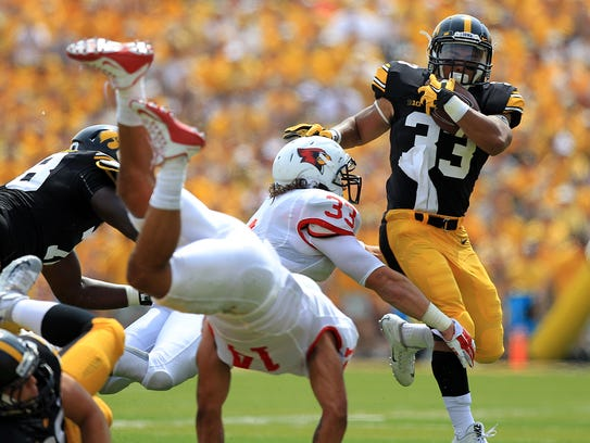 Iowa running back Jordan Canzeri breaks a tackle during