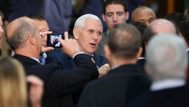 Supporters shot cell phone images of Vice President Mike Pence as he greeted them following remarks at the Trane Parts and Distribution Center in Louisville.Mar. 11, 2017