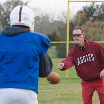Football coach, Todd Boyd, will lends his years of experience to the Tate High School varsity team during its championship run. Boyd was on the coach staff during the football team's last championship run.
