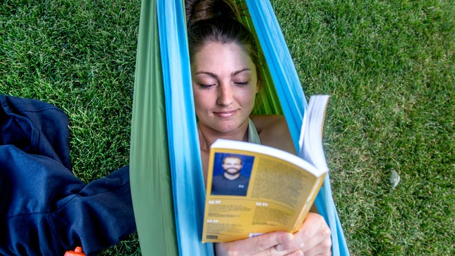 Bradley women's basketball player Gabi Haack, a senior education major, relaxes with a book and a hammock in 2020 on the Bradley campus. The highly decorated player will return to Peoria for a fifth season.