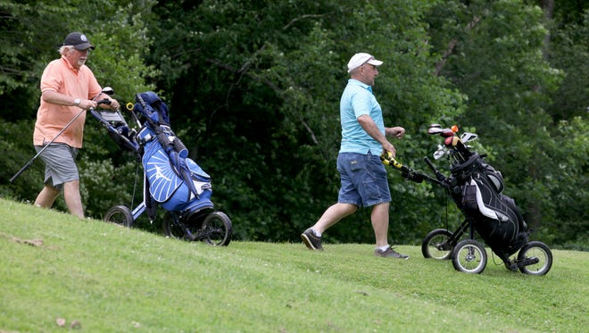 Brian Wooley of Pittsford and Guido Grimaldi of Greece walk down the 15th tee at Durand. Both have county golf passes and golf together twice a week.