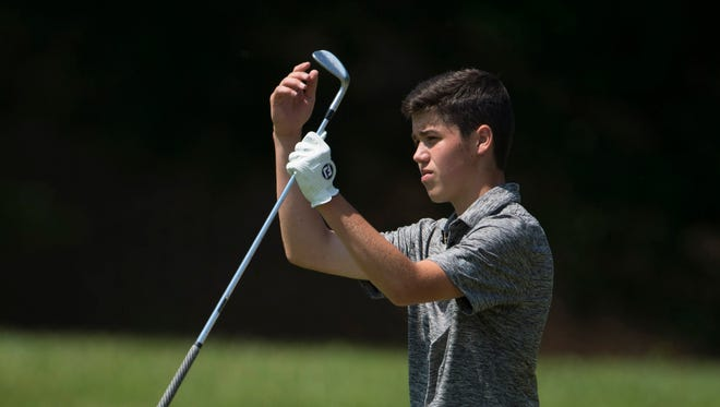 North's Eric Brinker encourages his ball to roll a little closer to the hole on the 8th green during the IHSAA Boys' Sectional at Oak Meadow Country Club in Evansville Friday morning. Briner shot a tournament best 68 and his North Huskies won the team title.