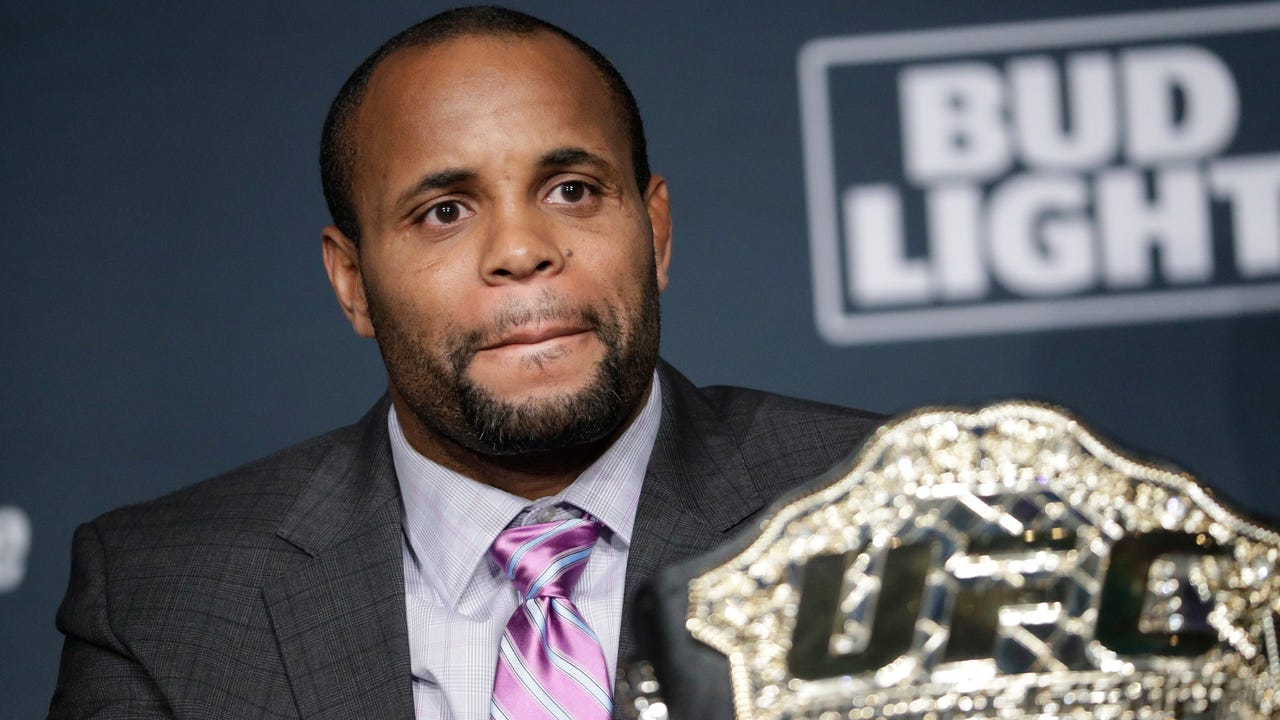 UFC light heavyweight champion Daniel Cormier addresses the media after his main-event title fight against Jon Jones was scrapped.