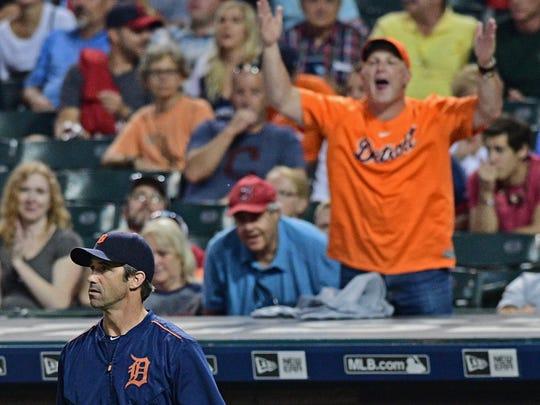 Tigers manager Brad Ausmus walks to the pitcher's mound.