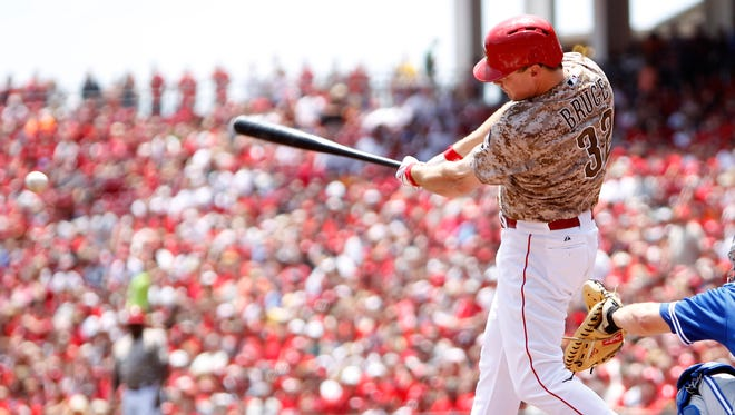 Jay Bruce singles in the first inning Sunday, when he went 2-for-4 with a double against Toronto.