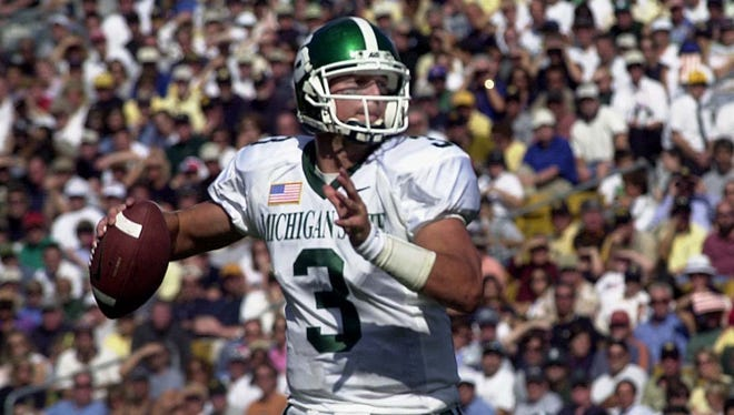 MSU's Ryan Van Dyke looks for a receiver against Notre Dame during their 2001 matchup.
