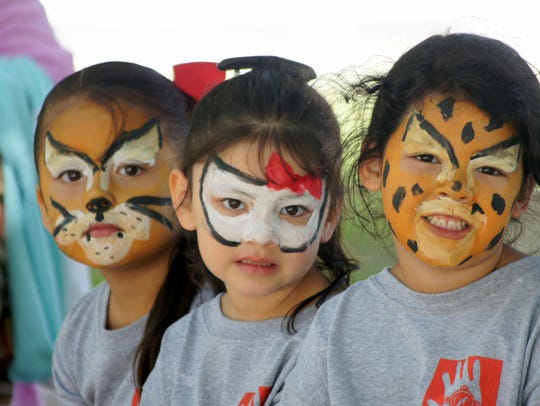 Face painting is a popular activity during the Day