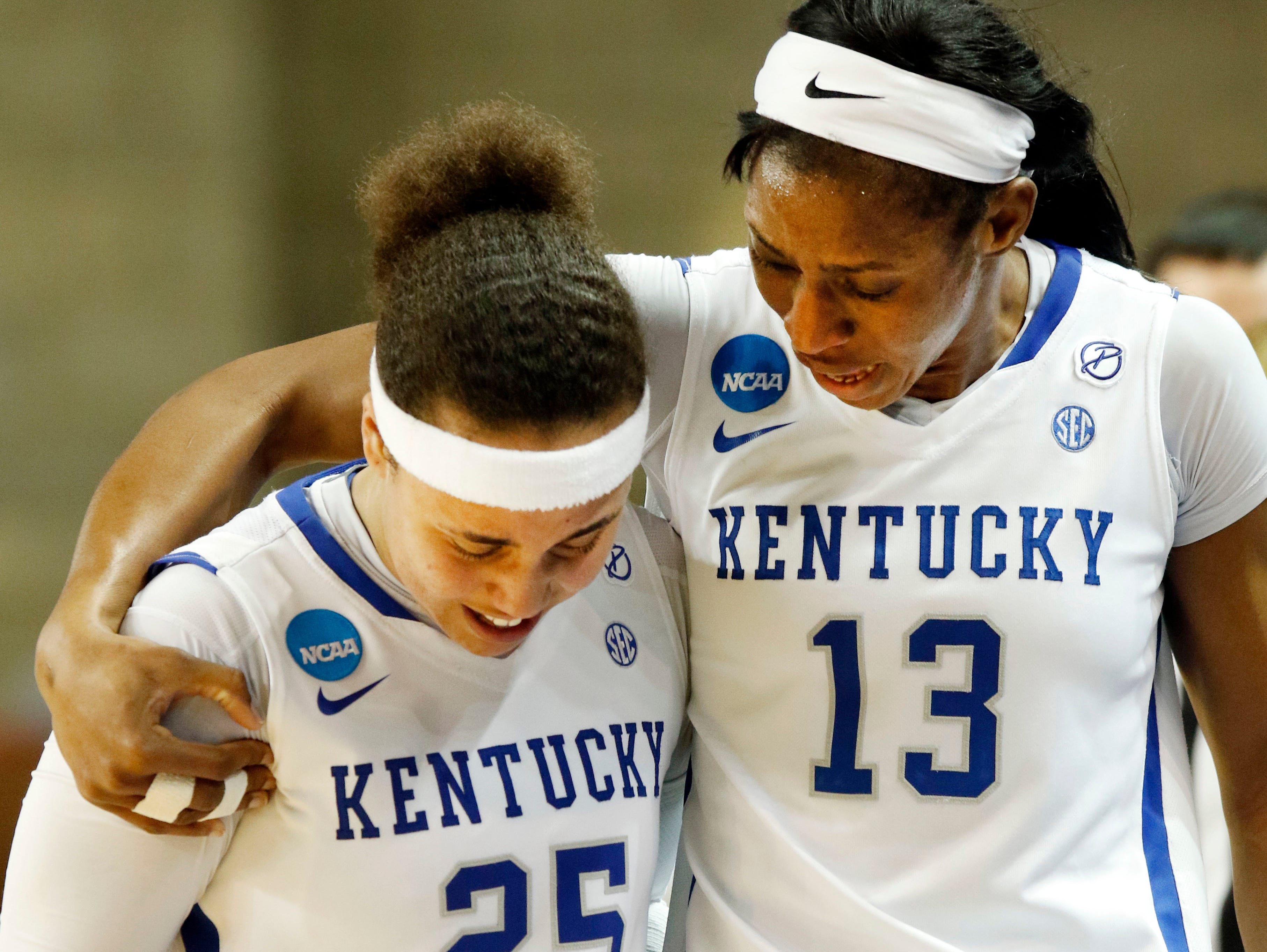 Kentucky's Makayla Epps (25) is consoled by teammate Evelyn Akhator (13) in the closing seconds of a second-round game in the women's NCAA college basketball tournament against Ohio State in Lexington, Ky., Sunday, March 19, 2017. (AP Photo/James Crisp)