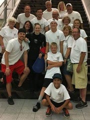 Spring Grove's Hali Flickinger, wearing black, poses with her family and friends during U.S. Olympic Team Trials in Omaha, Nebraska. Flickinger finished second in the 200 butterfly to earn a spot on the U.S. Olympic Team.