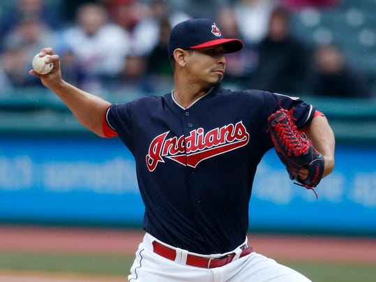 Cleveland Indians starting pitcher Carlos Carrasco delivers against the Detroit Tigers during the first inning of a baseball game Wednesday, April 11, 2018, in Cleveland. (AP Photo/Ron Schwane)