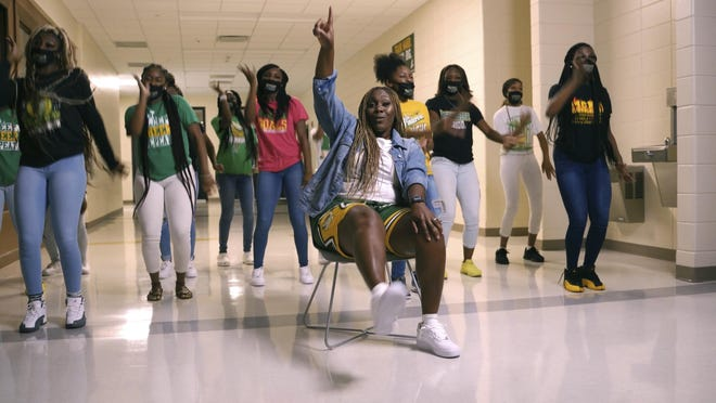 "In an image from a video provided by Overstreet Media Services, Callie Evans performs a remake of ""WHATS POPPIN"" by Jack Harlow on Aug. 11, 2020, in Albany, Ga. Evans made the rap video to motivate her students for a new school year amid the coronavirus pandemic."