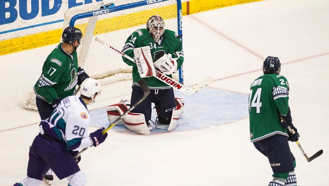 Florida Everglades goalie Alex Nedeljkovic takes a puck to the shoulder during Game 1 of the Kelly Cup Playoffs against the Orlando Solar Bears at Germain Arena in Fort Myers, Fla., on Wednesday, April 12, 2017.
