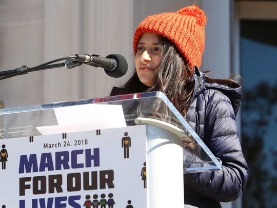 Bella Bhimani, lead student organizer, speaks to approximately 13,000 who marched in the Morristown March For Our Lives demonstration, a student-led nationwide protest demanding that the lives and safety of students become a priority and to end gun violence and mass shootings in their schools.  March 24, 2018. Morristown, NJ.