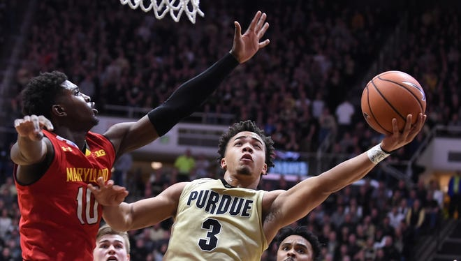 Sophomore guard Carsen Edwards slips in past Maryland's Darryl Morsell to score Wednesday night.