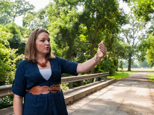 """Elizabeth """"E.B."""" Brooks, director of planning and design for Lafayette Central Park, Inc., explains various attractions and amenities to be added during construction at the Horse Farm in Lafayette, LA, Thursday, July 24, 2014."""