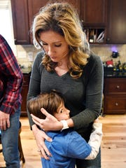 Laura Troup gets a hug from her youngest, Griffin, 6.She's a mother of three who is extremely passionate about AGAPE Nashville, an organization that, among other things, trains people to be foster parents and then works with DCS to place foster kids with families.Friday May 5, 2017, in Brentwood, TN