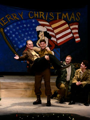Cast members in White Christmas rehearse for their opening night at the Pensacola Little Theatre. Cast members, from left, are A. Mark Palmer, William Li, Damon LaTorella and Blake Gilmore.