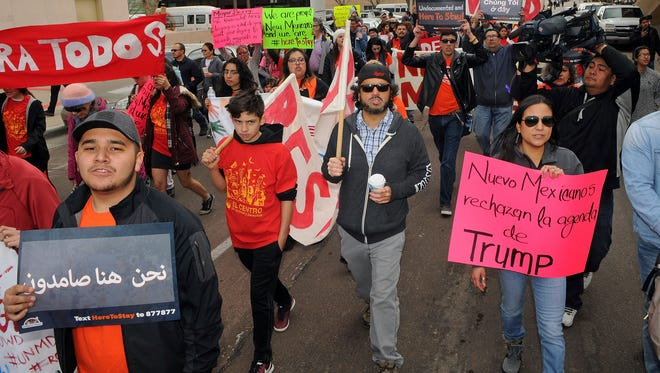 Supporters of immigrant groups joined the hundreds of people that marched from the University of New Mexico to Civic Plaza during the annual Martin Luther King Jr. march in Albuquerque, N.M., Saturday Jan. 14, 2017.