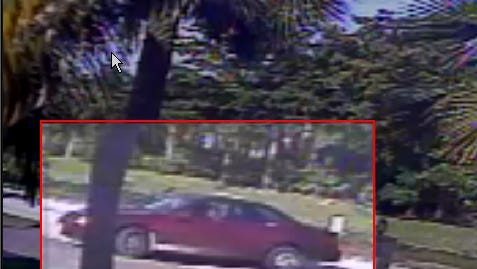 Surveillance camera shows the suspect's vehicle pulling into the driveway two minutes after the homeowner leaves.