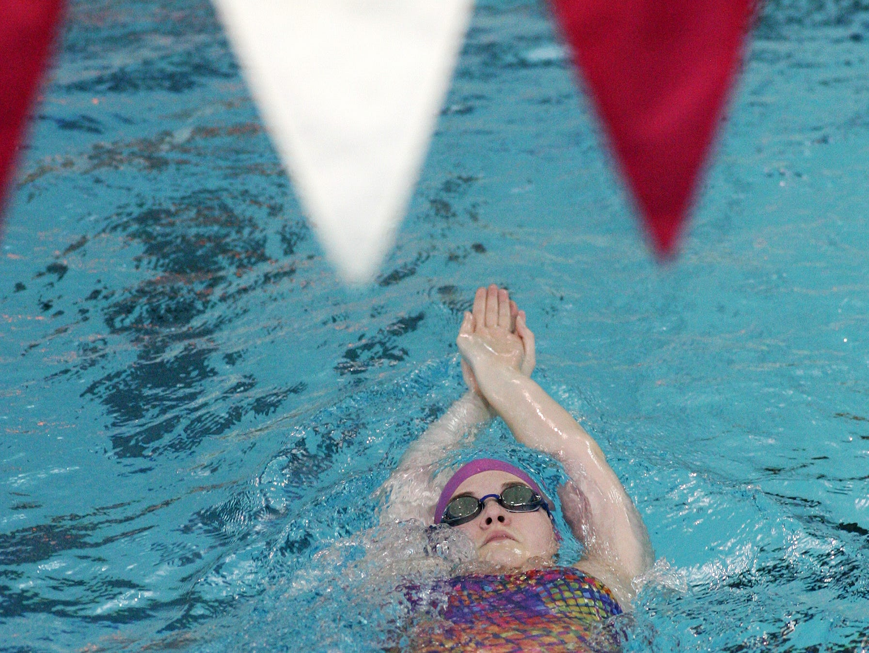 Lauren Cummons, 15, a freshman at Utica High School, practices with the Pau Hana swim club Tuesday at Denison.