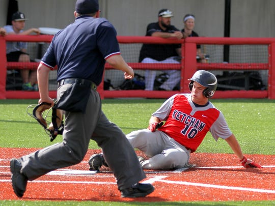Ketcham's Stephen Merrill slides into home plate with the third run of the third inning against Corning during Saturday's Class AA state quarterfinal at Corning Community College.
