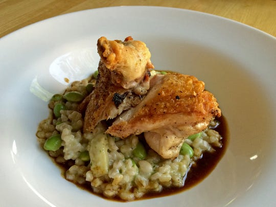 The Roasted Chicken Breast at King's Landing Bistro in Springdale is served with an artichoke and barley ragout, edamame, pecorino and natural jus.