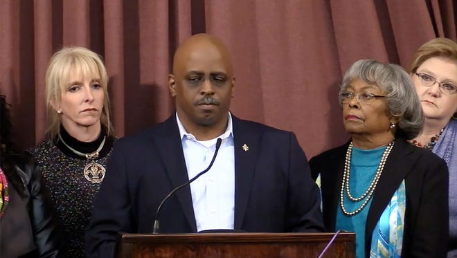 Metro Council members led by David James, center, attended a press conference discussing the LMPD Explorer program scandal. Other members are Angela Leet, back left, Mary Woolridge, and Marianne Butler, back right.