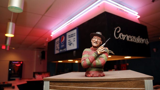 A Freddy Krueger figurine stands guard at the concession stand at the former Courtyard Cinemas on Lebanon Pike. The defunct movie theater is being transformed into a tattoo parlor, haunted house and smaller theater.