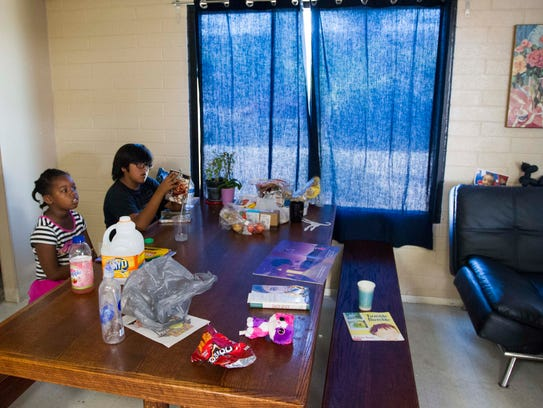 Children relax in a day room at Family Promise of Greater