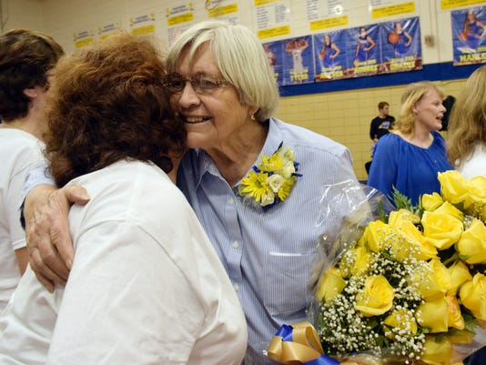 Fomer Buckeye High School basketball player Nancy Johnson (left) who played basketball for Stella Bass Sasser (right) from 1979-82 hugs her former coach Friday night. The gymnasium was dedicated to Sasser in a ceremony after the girls' basketball game and a reception followed after the boys' game. Sasser coached basketball for 33 years. Her family along with former players, coaches, colleagues and others who knew Sasser were in attendance for the event.