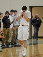 West De Pere's Cody Schwartz (33) reacts after missing