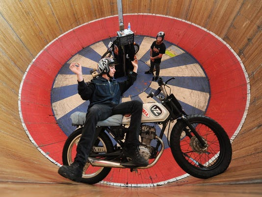 """Kyle Ives, of the Ive's Brother's Cycle, tests out the """"Wall of Death"""" before a performance at Harley-Davidson's open house last year. The event returns with stunts, tours, free demo rides and more Sept. 24-26."""