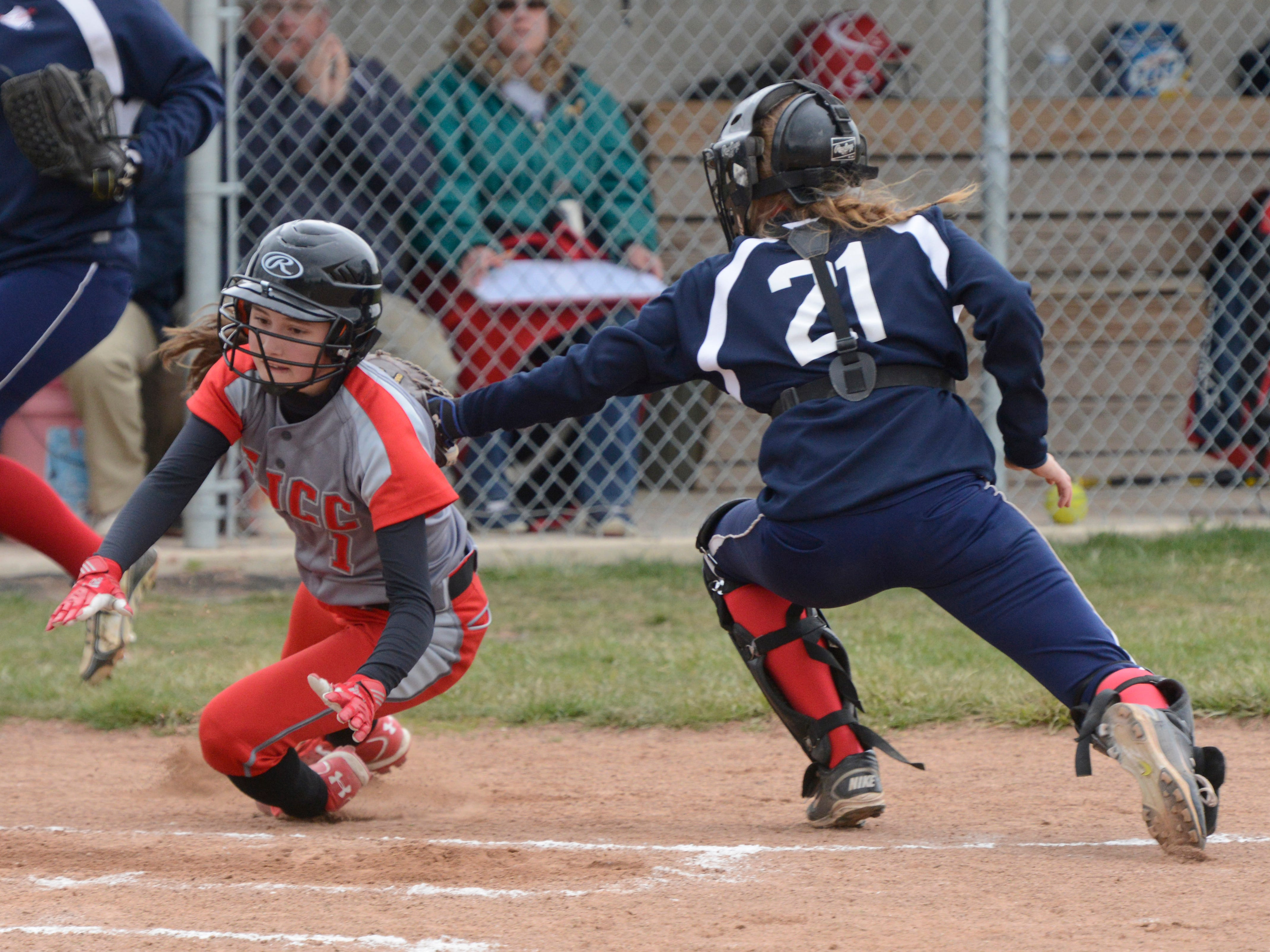 St. Joseph Central Catholic's Miranda Wammes is tagged out at home by Lakota catcher Bree Long-Meyer in the top of the third inning at Lakota High School. Lakota won 10-0 on Monday.