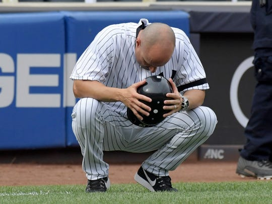 New York Yankees third base coach Joe Espada reacts
