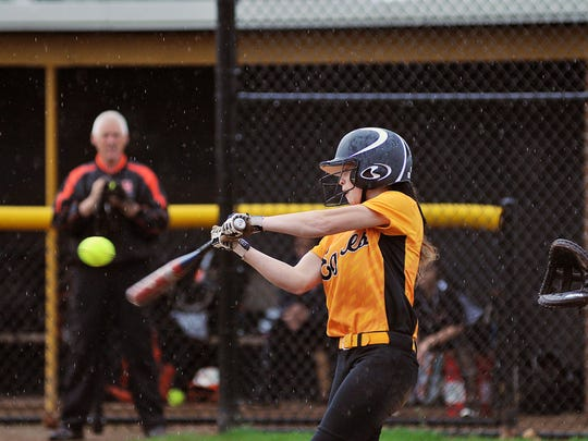 Colonel Crawford sophomore Alexus Burkhart connects with a ball in a game against Upper Sandusky earlier in the season.
