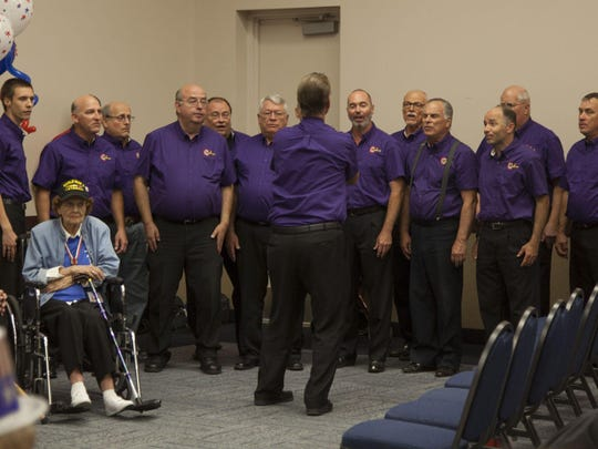 The Color Country Chorus sings at the welcome-home reception for Utah Honor Flight veterans June 6.