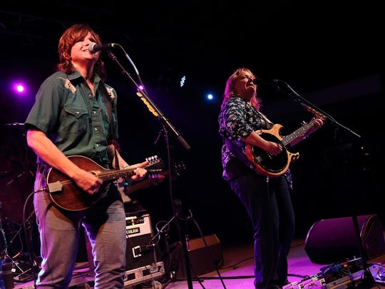 The Indigo Girls (Amy Ray, left, and Emily Saliers) read The New York Times while on the road.