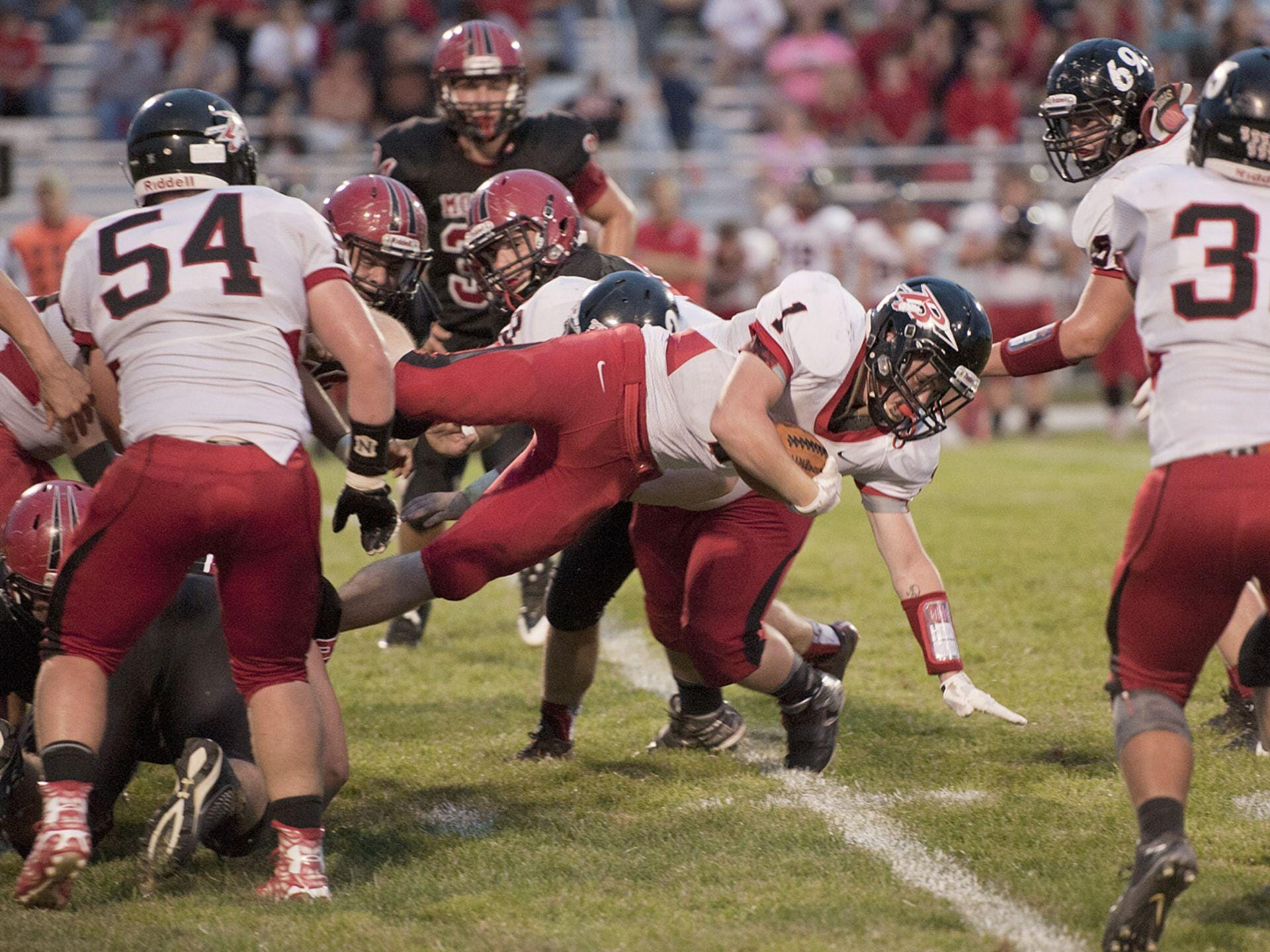 Bucyrus running back Bailey Johnson dives for a gain last friday against Mohawk.