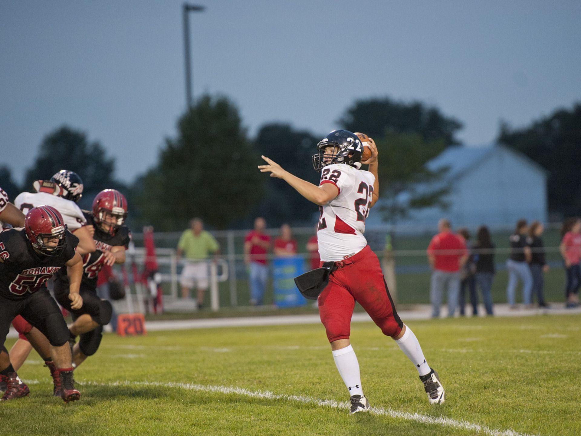 Bucyrus quarterback Gavin Lewis attempts a pass against Mohawk last week.