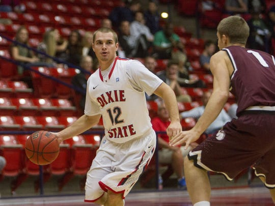 Dixie State guard Mason Sawyer makes a pass against Seattle Pacific at the Burns Arena Saturday, Nov. 14, 2015.