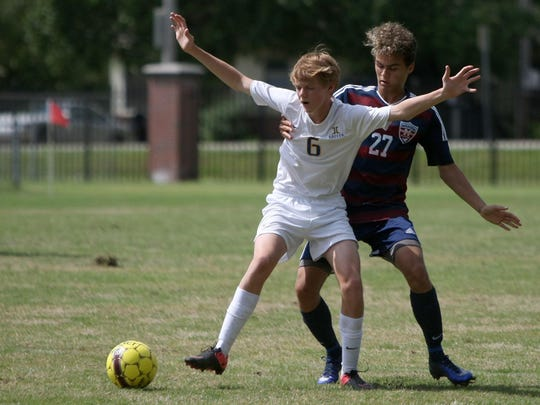 Jackson Christian's Weston Fallert and Madison's Joey Soriano battle for the ball in the District 15 A-AA championship game.
