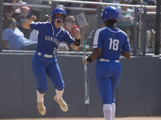 Donovan Catholic's Alexa Pagano celebrates after crossing