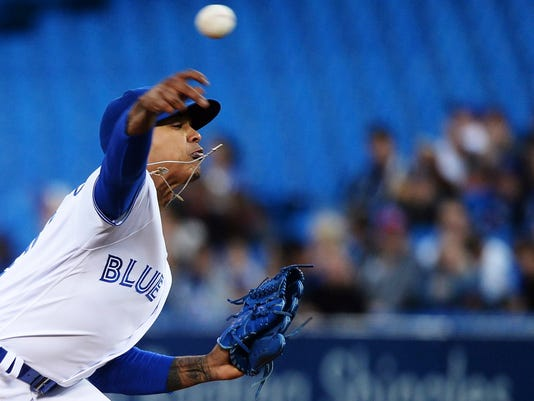 Toronto Blue Jays starting pitcher Marcus Stroman works against the Detroit Tigers during the first inning of a baseball game in Toronto on Friday, Sept. 8, 2017. (Nathan Denette/The Canadian Press via AP)