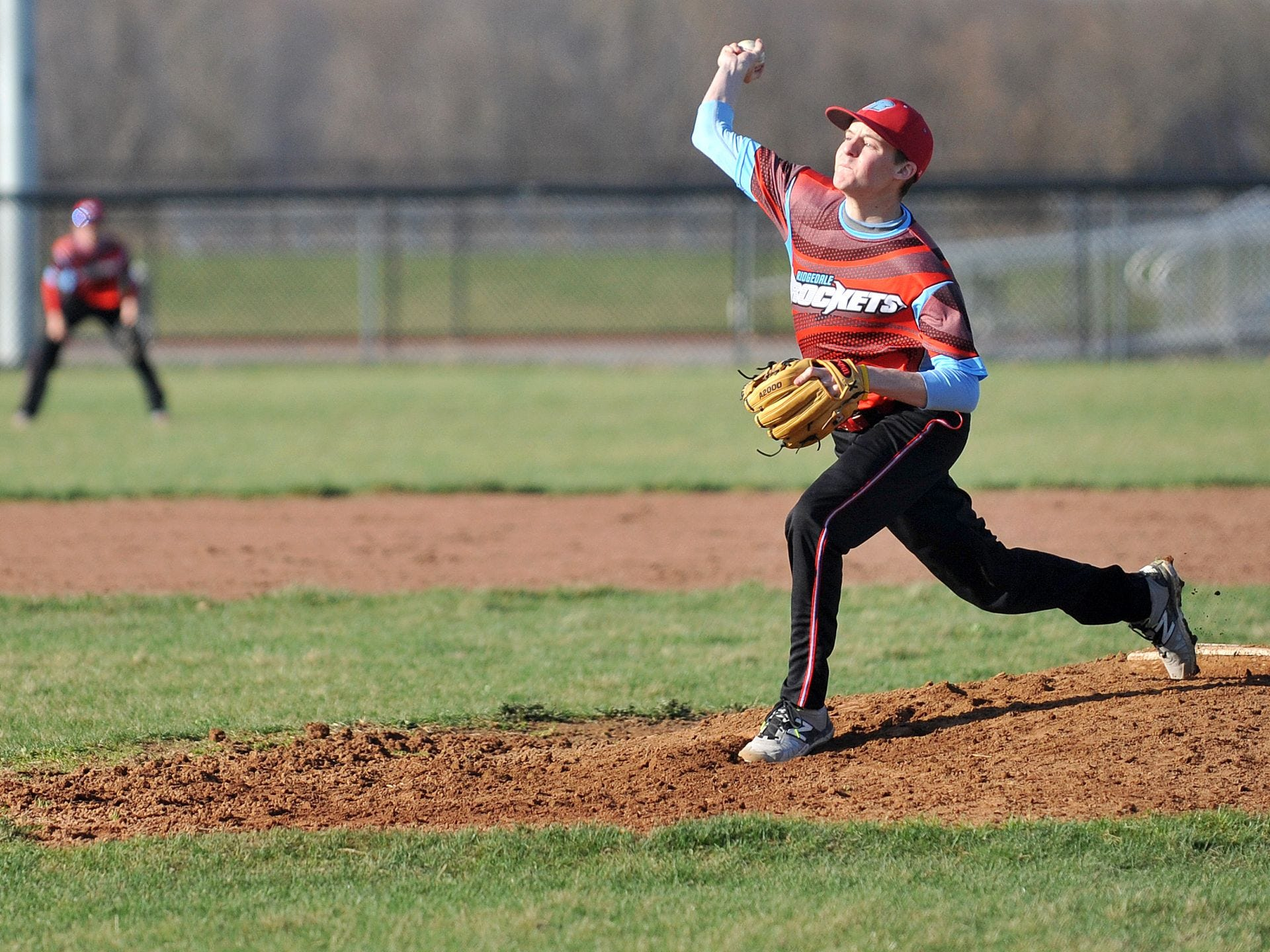 Ridgedale junior pitcher Monroe Britton delivers a strike during a Friday evening game at Crestline High School.